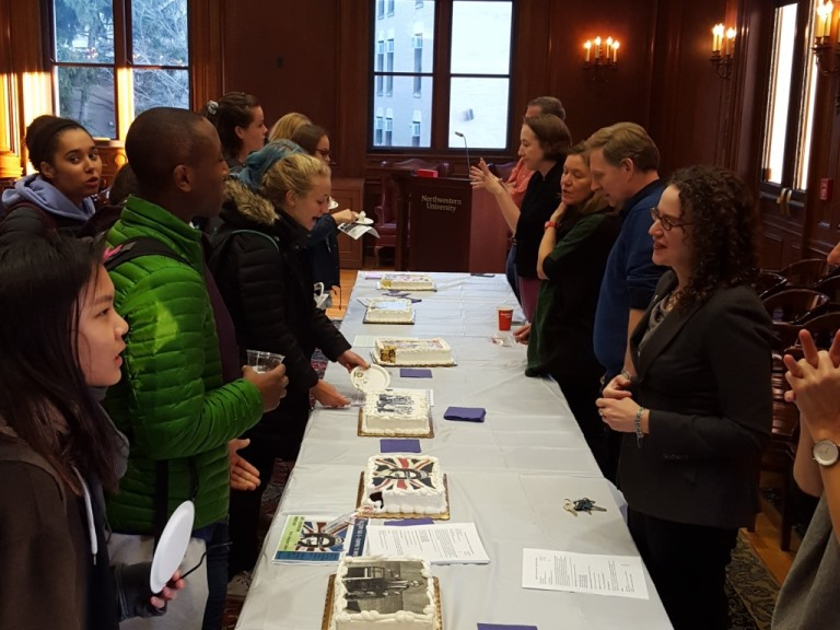 History professors speak with students about their upcoming Winter Quarter classes, serving cake